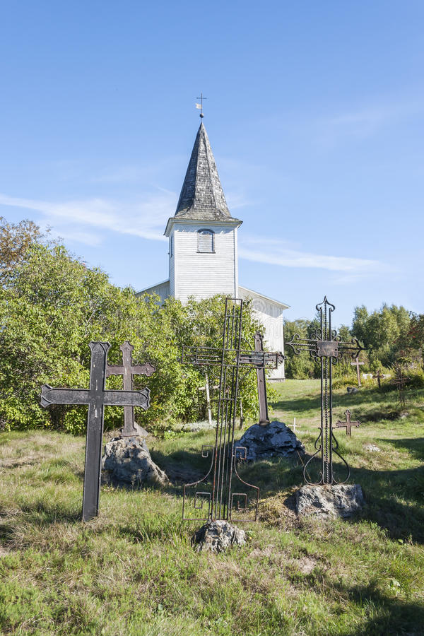 Graveyard crosses and white church in Estonia royalty free stock photos