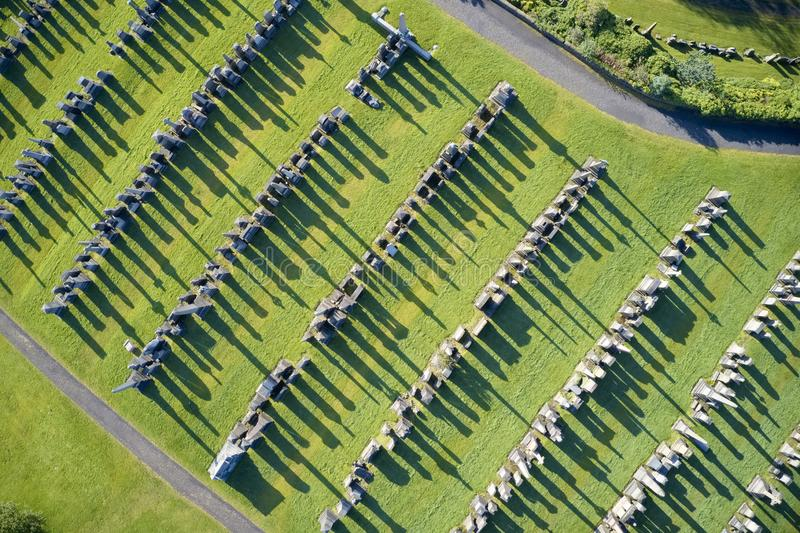 Graveyard necropolis with many headstones aerial view long shadows from gravestones in Glasgow UK stock photography