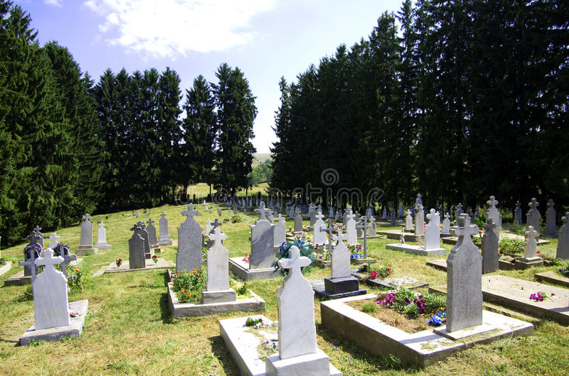 Graveyard. In a remote village, cemetery with many tombstones stock photography