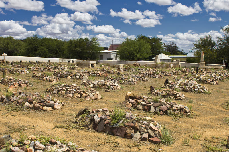 Graveyard with rocks on graves