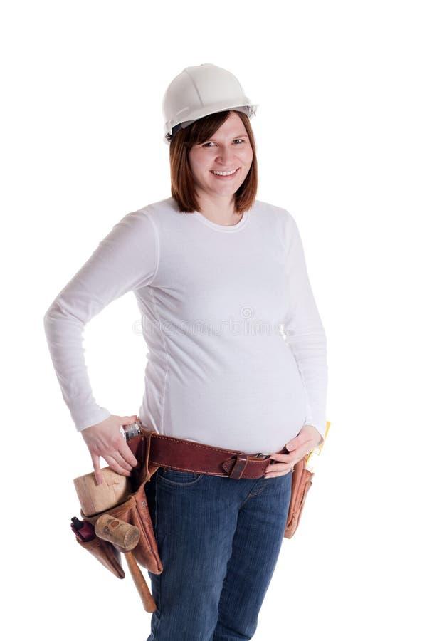 gravid arbetare för konstruktion fotografering för bildbyråer