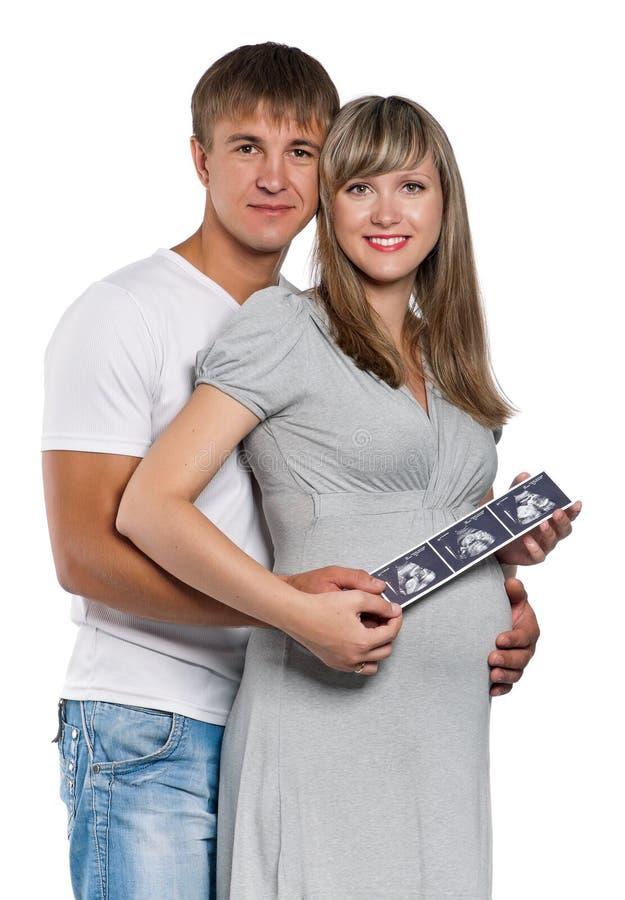 Gravid kvinna med makan arkivfoto
