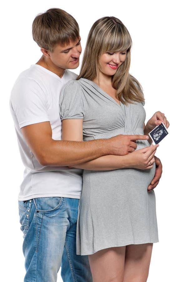Gravid kvinna med makan arkivfoton