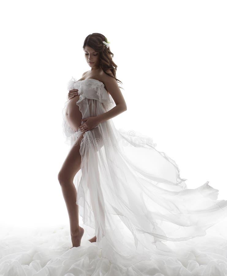 Gravid kvinnaklänning, havandeskapmoderskapbegrepp, härliga Wav arkivbilder