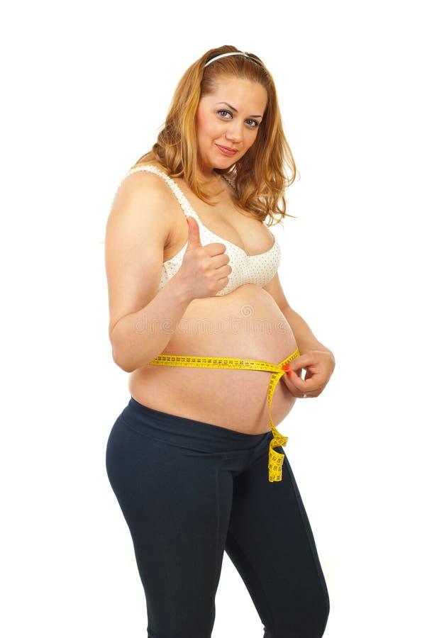 Download Gravid Lyckad Tummy För Mätning Fotografering för Bildbyråer - Bild av förväntansfullt, kvinnlig: 19793325