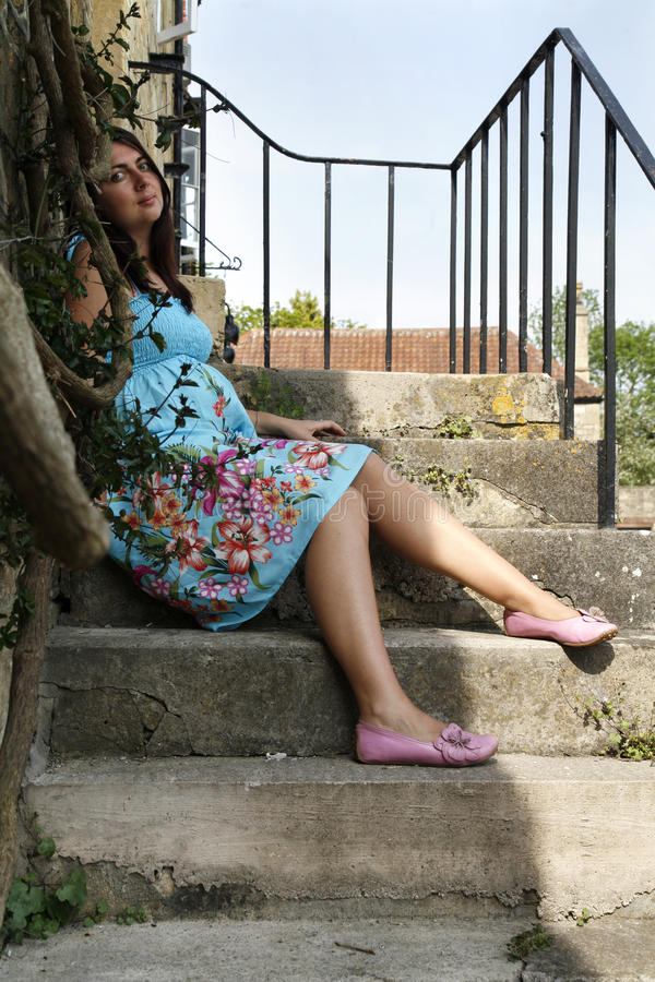 gravid privat sittande momentkvinna för hou royaltyfri bild