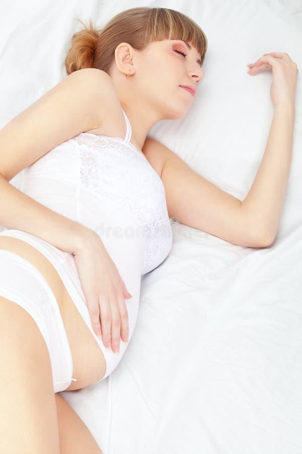 gravid vit kvinna för underlag fotografering för bildbyråer