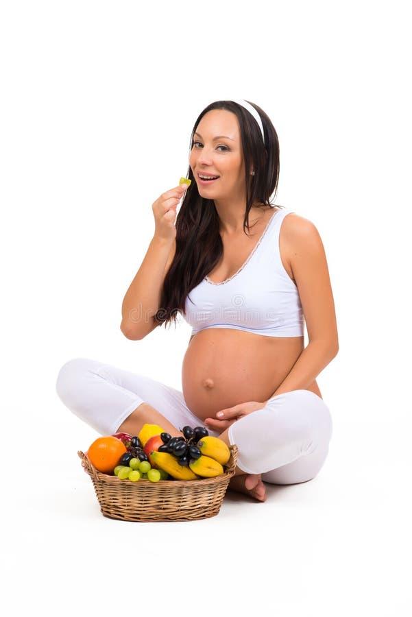 Gravidanza, salute e bellezza Nutrizione adeguata Vitamine e frutta per le donne incinte fotografia stock libera da diritti