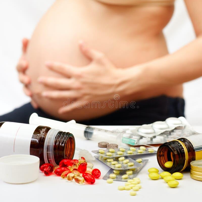 Gravidez e medicinas imagem de stock