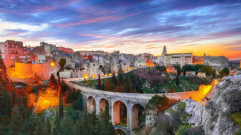 Gravina in Puglia ancient town, bridge and canyon at sunrise stock photography