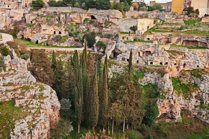 Gravina in Puglia, Bari, Italy: the ancient cave houses in the ravine wall royalty free stock photography