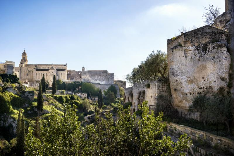 Gravina in Puglia: picturesque landscape of the the deep ravine and the old town with the ancient cathedral, Bari, Apulia, Italy royalty free stock photo