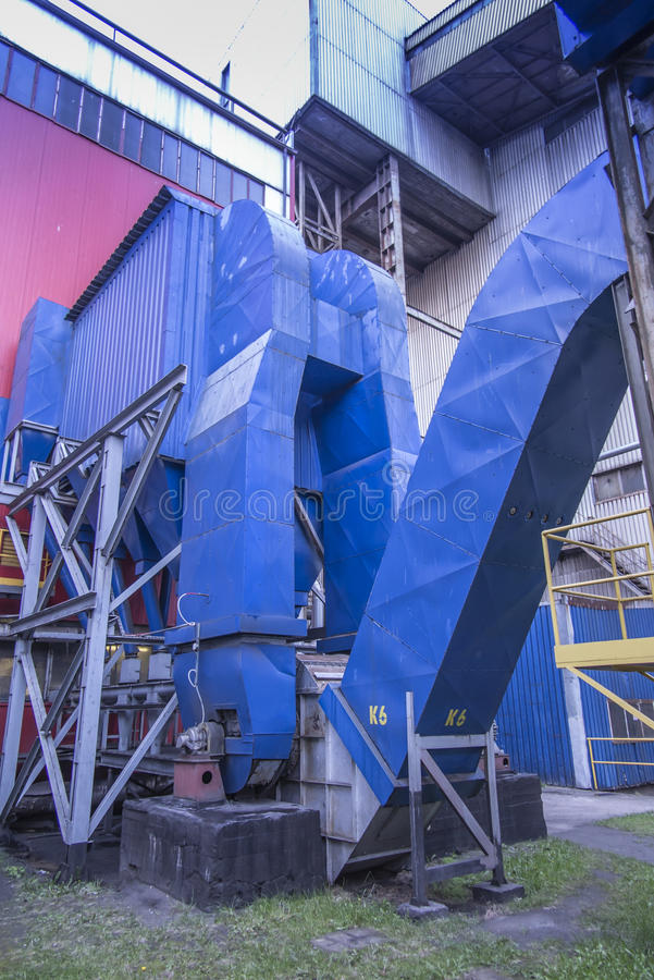 Gravity dust collector and exhaust fan behind coal boiler. Grate stock photography