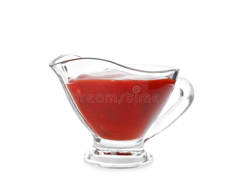Gravy boat with spicy chili sauce. On white background stock images
