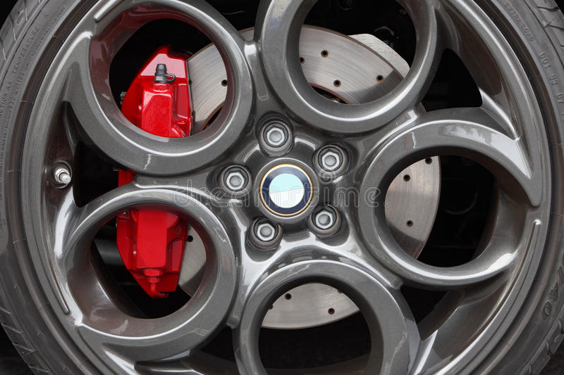 Gray alloy sports car wheel and disc brake close-up stock image