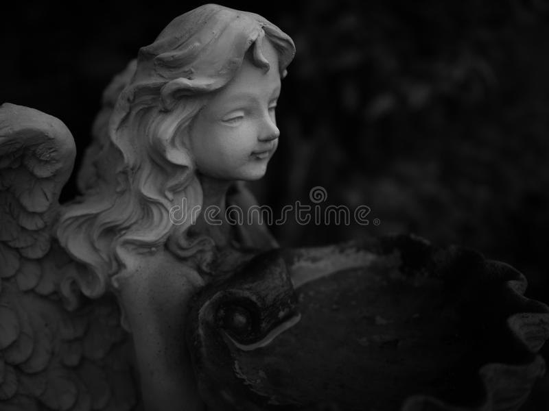 Gray angel plaster statue, Low key royalty free stock photos