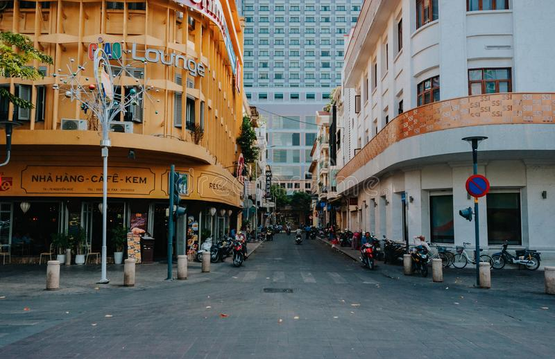 Gray Asphalt Street in Between Yellow and White Concrete Buildings at Daytime stock photography
