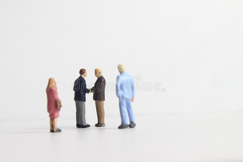 Gray Backgrond, Simple Illustration Photo for Mini Figure Two Man Toy Handshaking for Business Agreement Beyond their partner royalty free stock photos