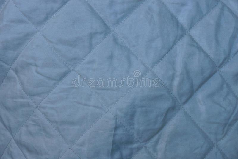 Gray fabric texture with a pattern on clothes stock photography