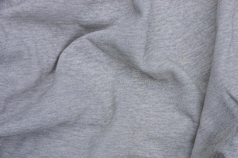 Gray texture of a piece of crumpled cloth from clothes. Gray background of a piece of crumpled cloth from clothes royalty free stock image