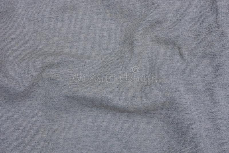 Gray texture of a piece of crumpled cloth from clothes. Gray background of a piece of crumpled cloth from clothes stock photography