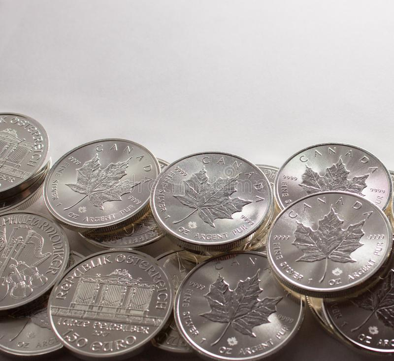 Investment silver coins Austrian and Canadian mints stock photos