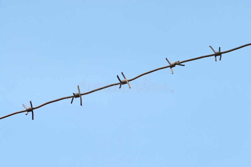 Download Gray Barbed Wire Isolated On Blue Stock Image - Image of clouds, line: 24548527