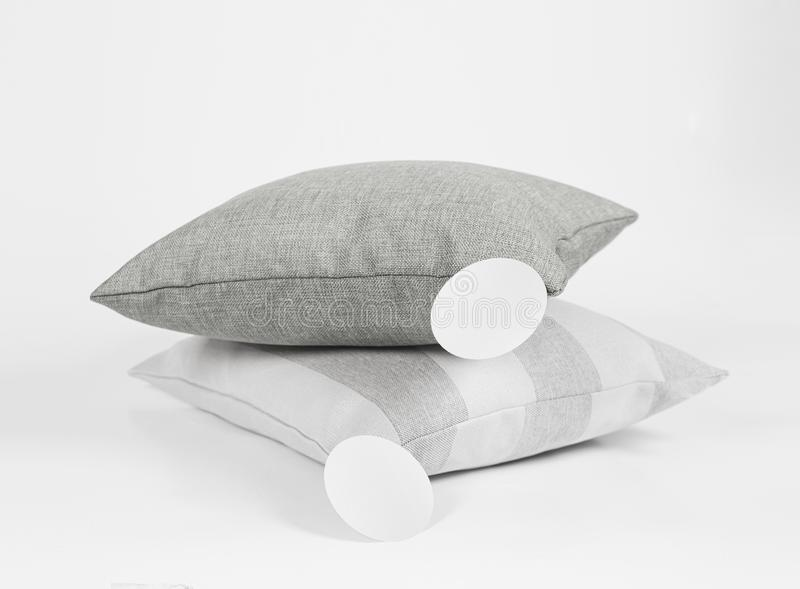 Gray and beige pillows on the white background royalty free stock images