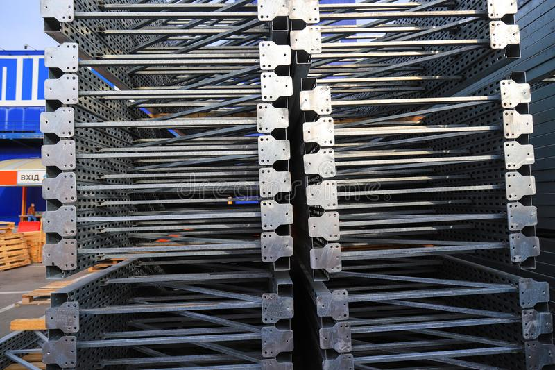 Gray big metal mobile shelving stacked in a warehouse of a construction shopping center. Shelves for placement and storage royalty free stock image