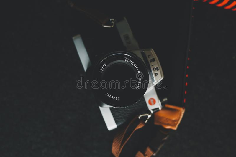 Gray and Black Leica Dslr Camera on Black Surface royalty free stock photo