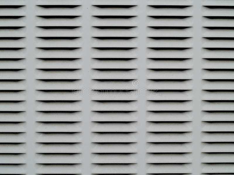 Gray and black metal ventilation grate royalty free stock photography