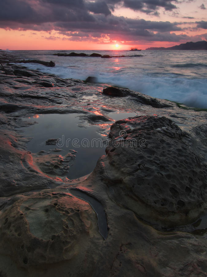 Gray and Black Rock Formation Near the Ocean during Sunset stock photos