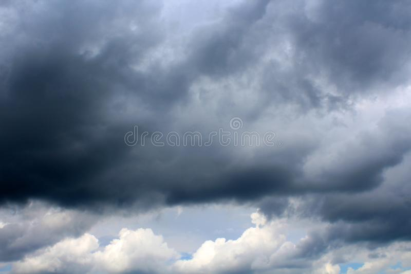 Simple pfoto image. A gray blue cloudy summer sky stock images