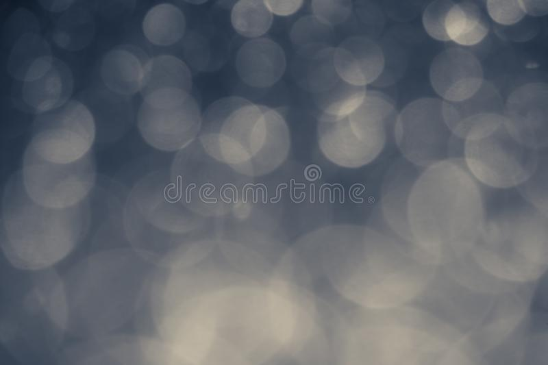 Gray and blue lights and bokeh background for event concept. Retro style royalty free stock images