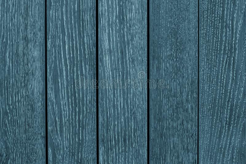 Gray and blue wooden planks of the oak table. Blue painted wooden boards. Texture of pine wood background. Gray-blue wooden board royalty free stock images