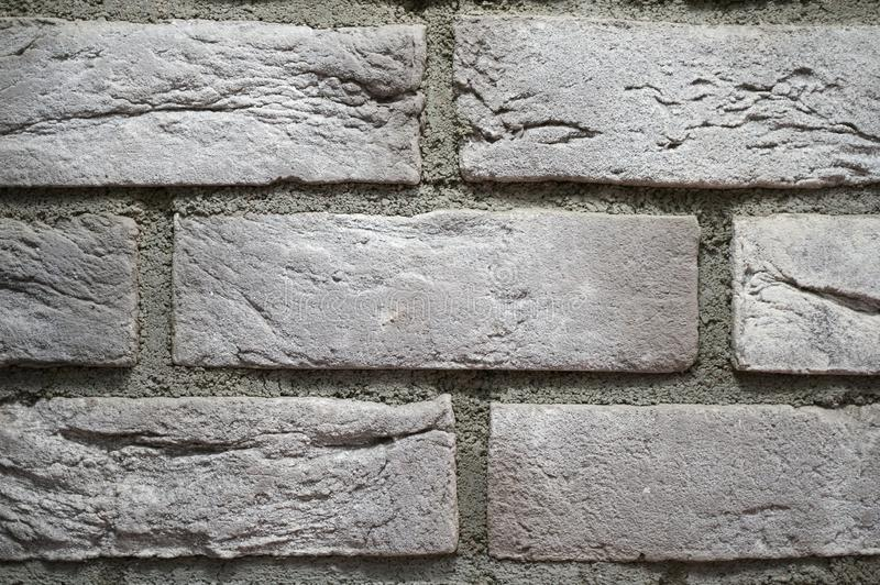 Gray brick wall close up. Universal vintage background royalty free stock photo