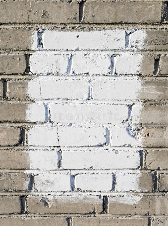 Gray brick wall with white painted rectangle stock photography