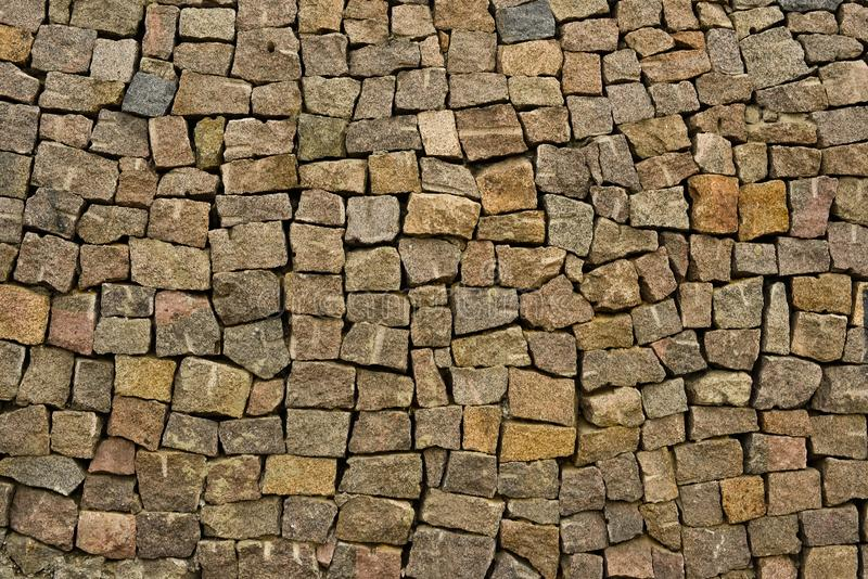 Background or Texture of  Stone Wall. Gray bricks. Black brick wall display wallpaper royalty free stock images