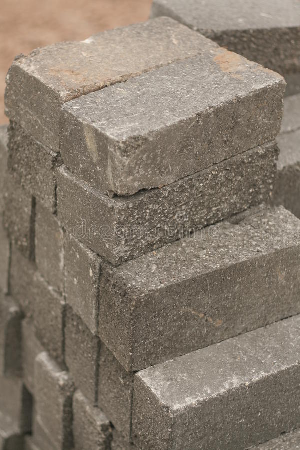 Gray bricks for building. Abstract of neat pile of stacked gray bricks ready to build royalty free stock photos