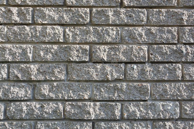 Gray brickwork used in the construction of a stone house. T royalty free stock images