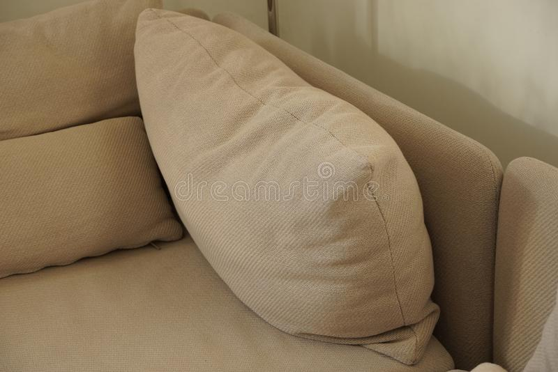Gray brown fabric pillows on the couch stock photo
