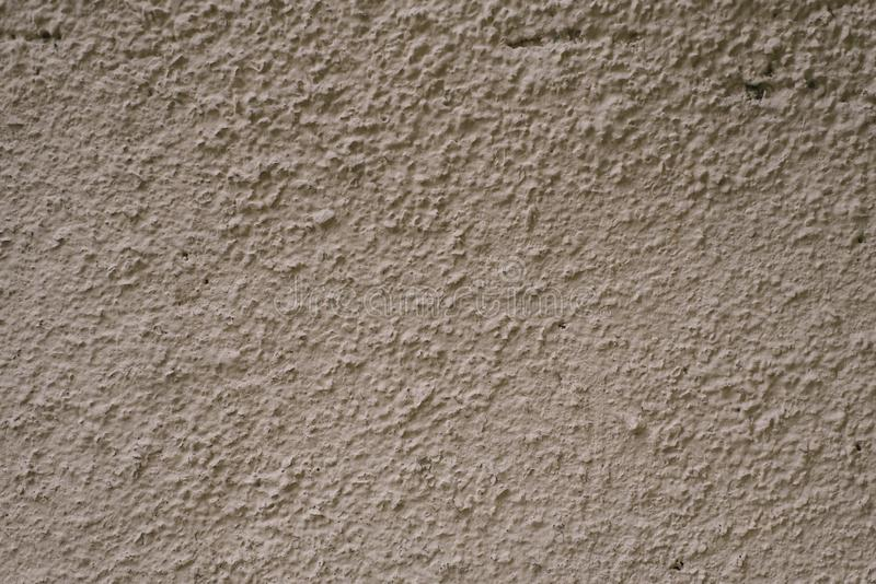 Gray-brown plaster wall. Building hair dryer. To copy space royalty free stock images