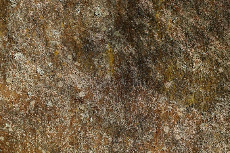 Gray brown stone texture from a piece of dirty granite stock photography