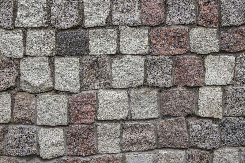 Gray building stone for paving walls and roads. Texture, background, paving stone stock photography