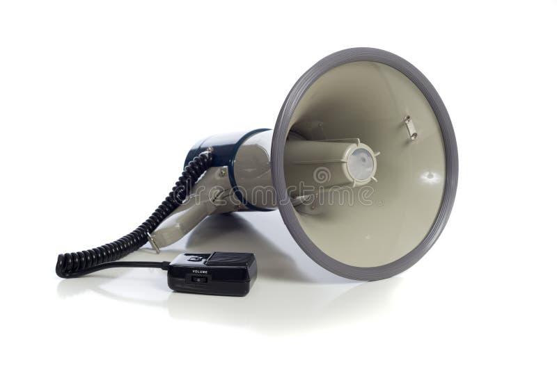 Gray bullhorn on white. A gray bullhorn/megaphone on a white background stock photography