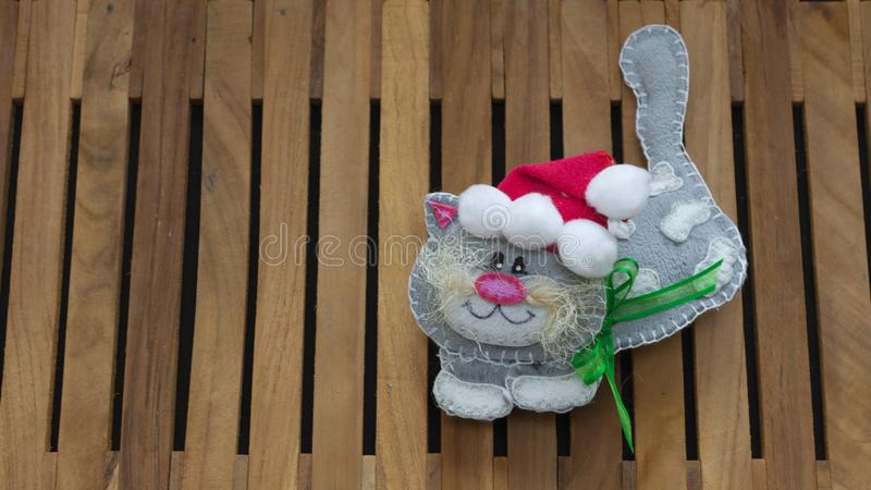 Gray cat with red santa claus hat made in foamy for christmas decoration stock photo