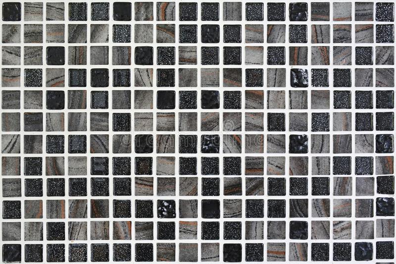 Gray ceramic mosaic using on wall background.  royalty free stock photo