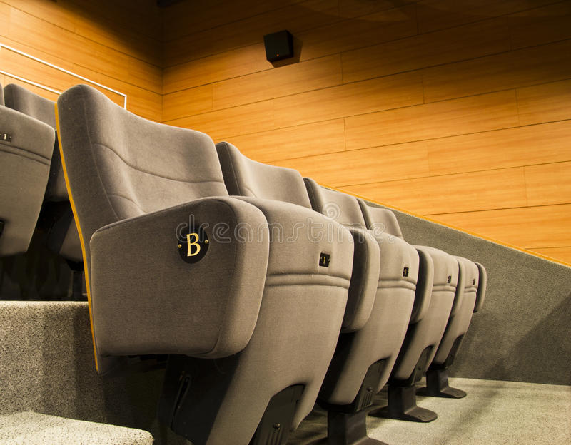 Gray chair of a cinema or theater royalty free stock photo