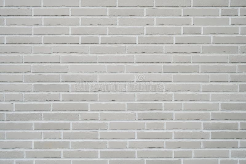 Gray clinker brick wall background. Modern building exterior with brick slip cladding royalty free stock image