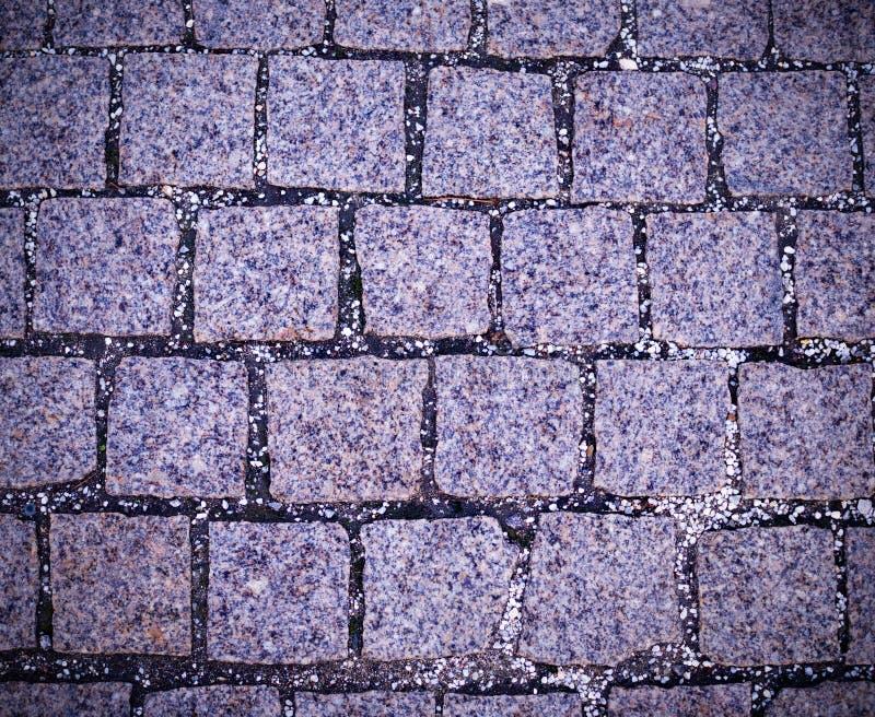 Cobblestone tiled sidewalk pavement with vignette. background, texture. Gray cobblestone tiled sidewalk pavement with vignette. background, texture stock photo